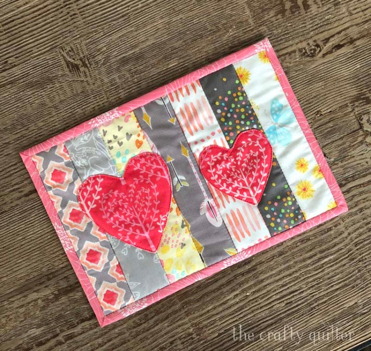 Quilt As You Go Mug Rug Tutorial (with applique) @ The Crafty Quilter.  Features 3 different designs:  fall leaves, black cat, and hearts