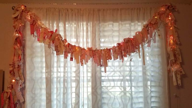 Lighted scrap fabric garland tutorial @ The Crafty Quilter.  This easy decoration can be made for any holiday using fabric, ribbon, tulle or lace!