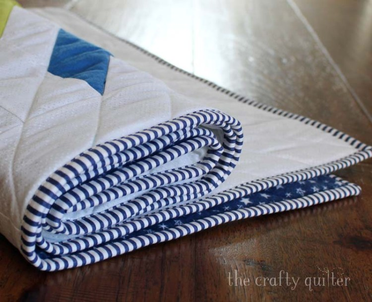 My latest finish is an adorable baby quilt for Benjamin, my grandson.  Striped binding is my favorite! The quilt pattern is Glacier Modern Quilt by QLT Studio.