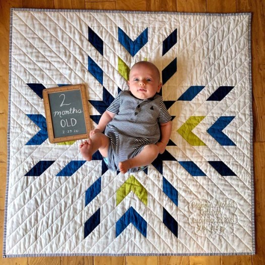 Baby Benjamin on baby quilt made by Julie Cefalu.  Pattern is Glacier Modern Quilt by QLT Studio.