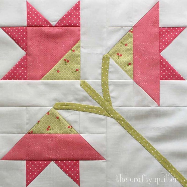 "The Carolina Lily Quilt Block is a free block pattern from Fat Quarter Shop that measures 14 1/2"" square.  This one is made by Julie Cefalu at The Crafty Quilter."