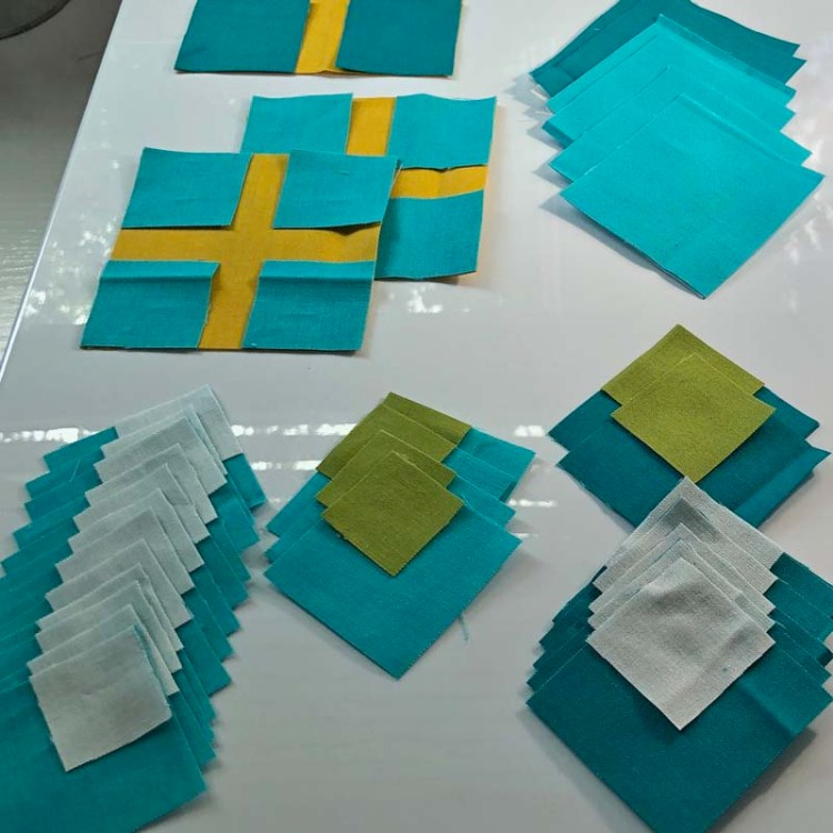 Tips for fast and efficient piecing @ The Crafty Quilter.  Use glue instead of pins and use Diagonal Seam Tape instead of drawing diagonal seam lines.
