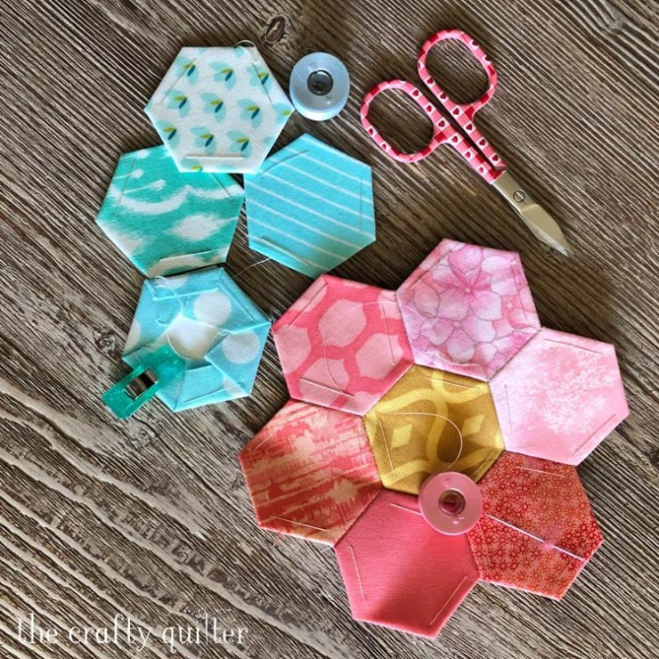 Hand stitching projects include these English Paper Pieced hexagon flowers @ The Crafty Quilter
