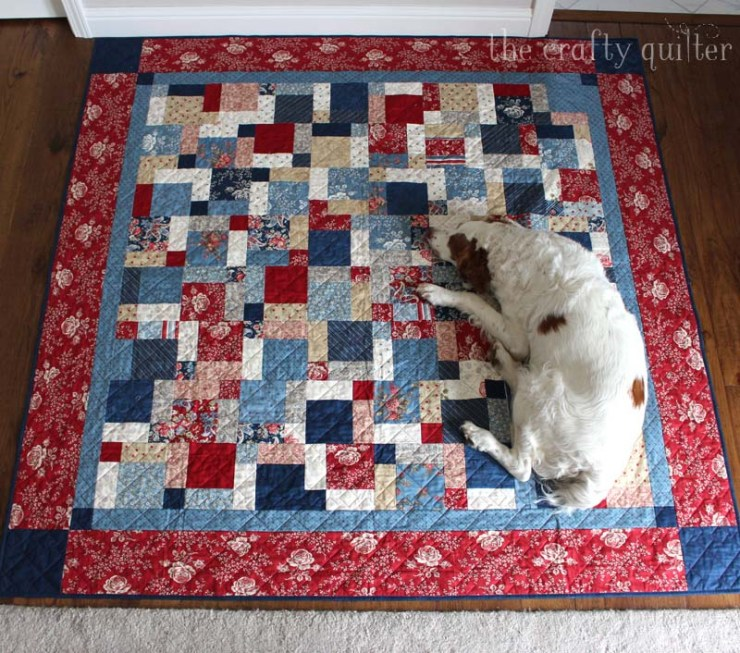 Disappearing nine patch quilt made by Julie Cefalu @ The Crafty Quilter and her helper Cooper
