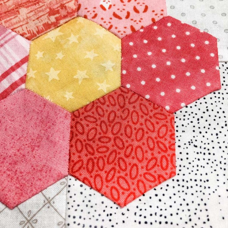 My stitches disappear with 80 wt. Quilter's Select thread on these English Paper Pieced hexagon flowers @ The Crafty Quilter