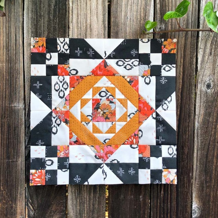 Block 9 of Red at Night BOM 2 using Kismet fabric.  Made by Julie Cefalu, pattern by Bound to be Quilting
