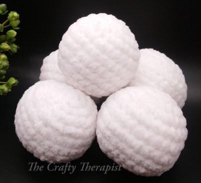 Snowballs crochet pattern by Janferie MacKintosh, The Crafty Therapist. Pattern also includes a cute Santa sack crochet bag pattern.