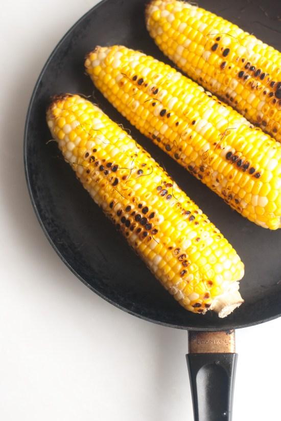 Corn Cobs blackened in skillet.
