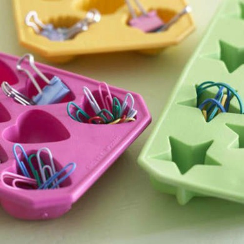 Sort your junk drawer or miscellaneous office supplies with an ice cube tray.