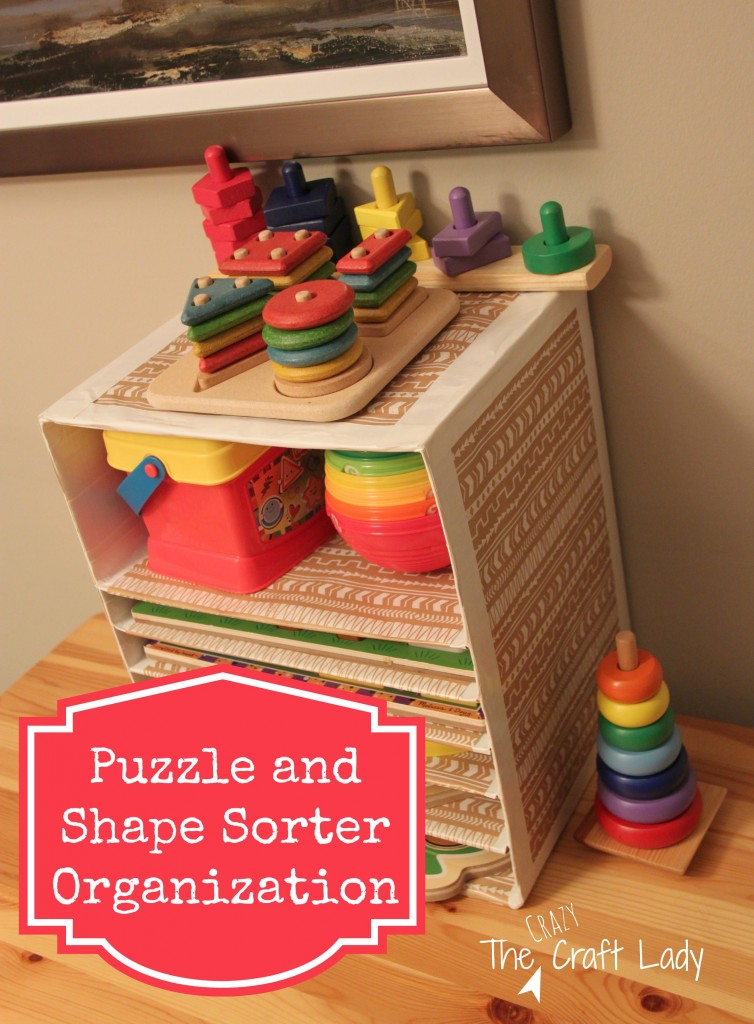 Make a shelf for all of those puzzles and stacking toys using cardboard, duck tape, and wrapping paper.