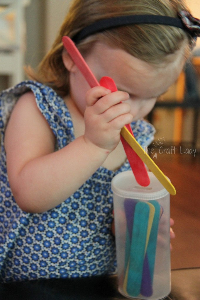 Popsicle Stick Fine Motor Activity with a Crystal Light Container