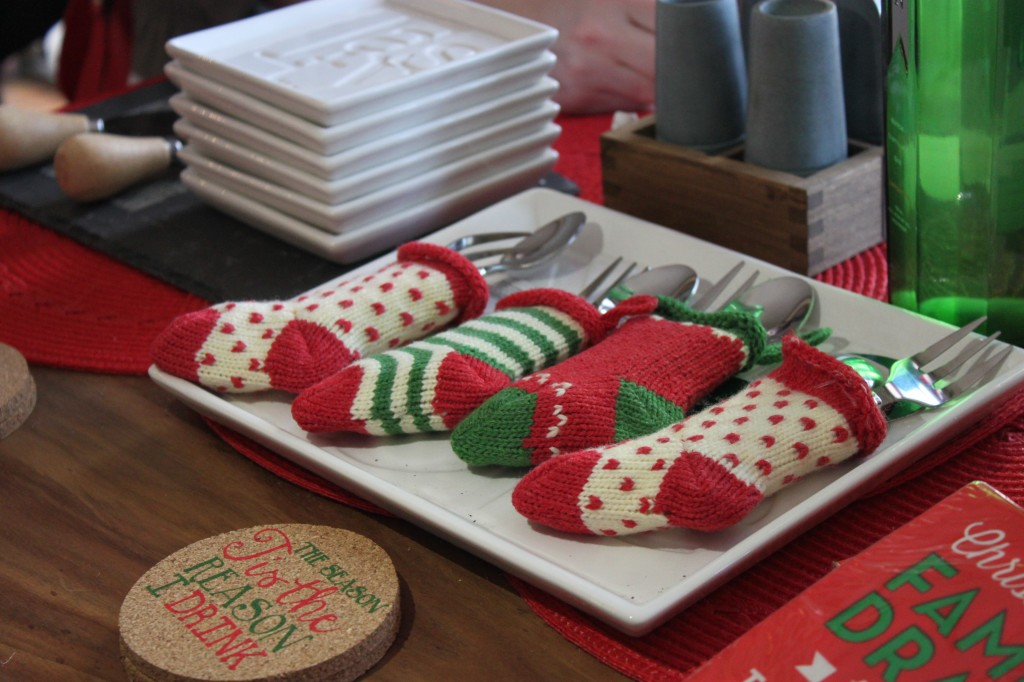Use mini knit stockings to hold silverware on your holiday buffet - the Winter Ideas House 2014