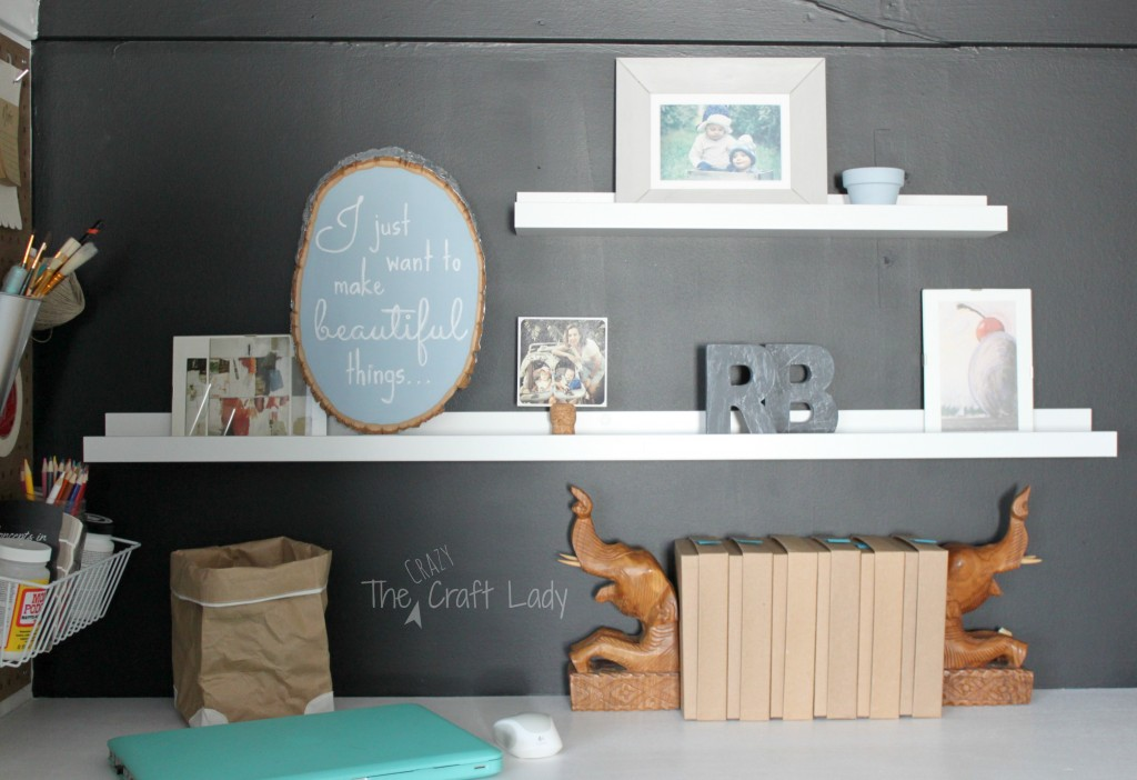 Floating shelves to display pictures above a work space