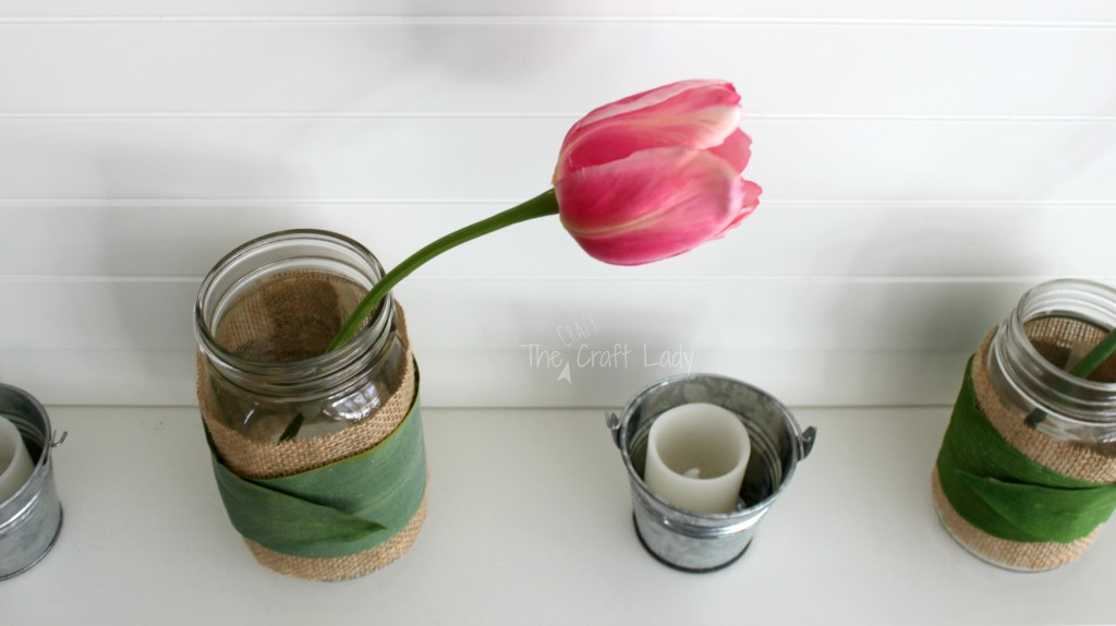 Wrap Mason jars with burlap and leaves for easy spring-inspired decor