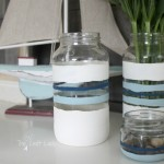 Trash-to-treasure crafts are the best! Turn old spaghetti sauce jars into adorable nautical stripe vases using chalk paint. This is such an easy, inexpensive, and beautiful craft!