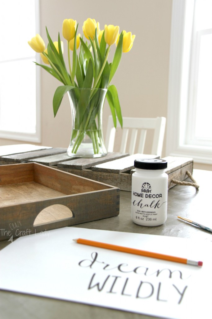 Upcycle a wooden Melissa & Doug toy box into a decorative serving tray! What an awesome DIY craft idea that comes together in a snap with a little bit of stain and paint.