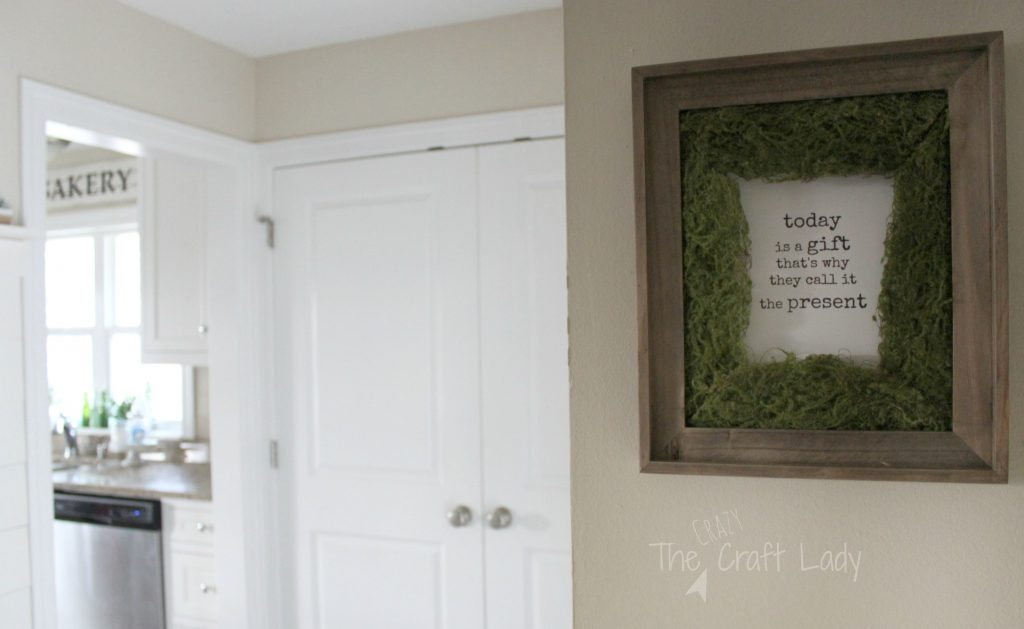 DIY Moss Picture Frame Photo Mat + A Free Printable - DIY this simple home decor craft! Did you know you can buy ribbon rolls of faux moss? Follow this tutorial to make a unique moss photo mat and feature a favorite image or print this FREE printable.