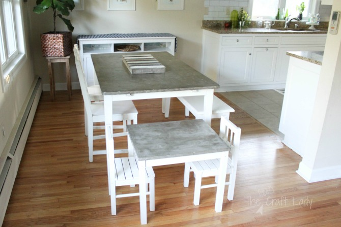 Follow this step-by-step tutorial with tips + tricks to make a DIY concrete table top that is finished, sealed, and food-safe. It's a great durable option for a table top!