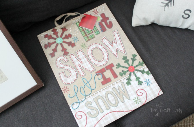 Dollar Store Christmas Decorations - use gift bags for instant wall art