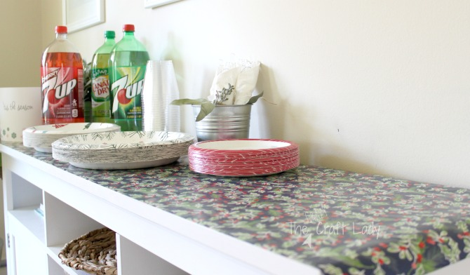 Easy Holiday Entertaining tip - use wrapping paper instead of a tablecloth for easy clean up