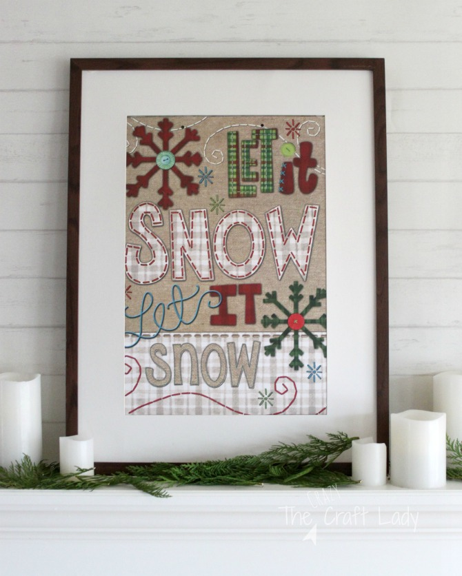 Frame Dollar Store Christmas gift bags for easy and inexpensive wall decor