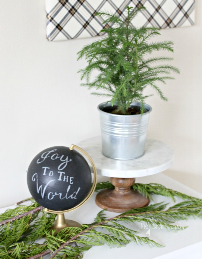 Using greenery and chalkboard paint for inexpensive Christmas decor