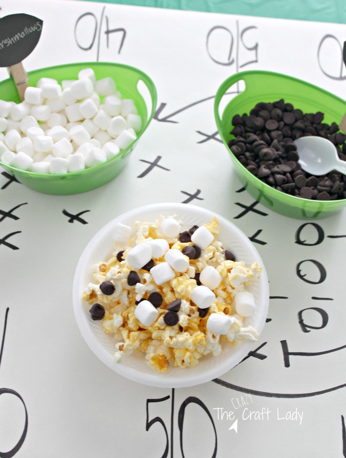 Making Football Popcorn Snack Mix