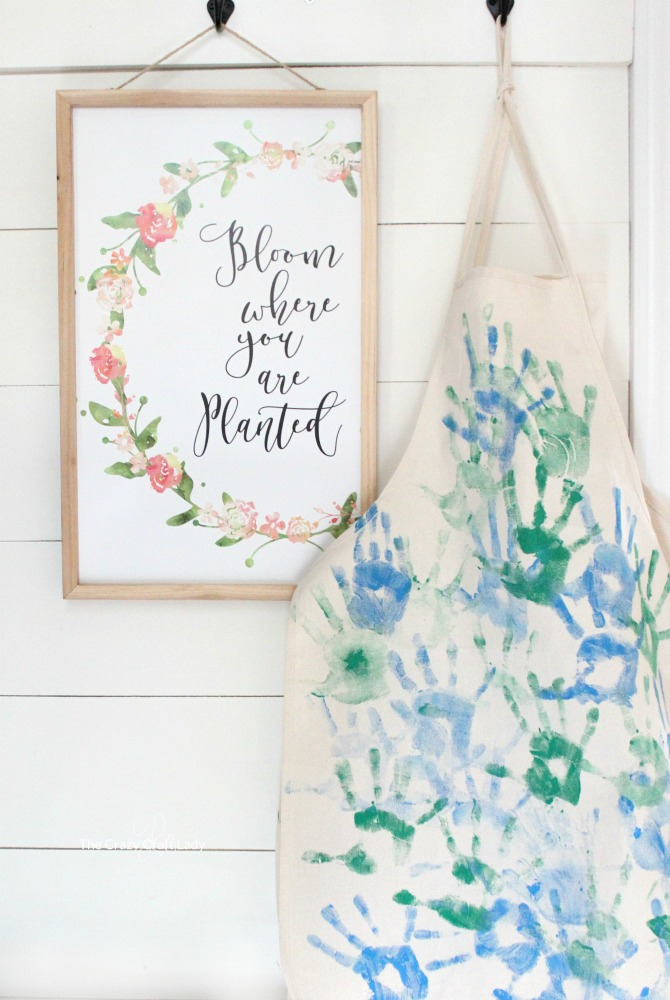"""Make a personalized kids apron with your """"kitchen helpers"""". They will love customizing their own aprons with hand prints and paint!"""