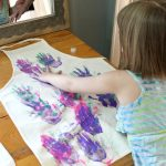 """Make these personalized kids aprons with your """"kitchen helpers"""". They will love customizing their own aprons with hand prints and paint!"""