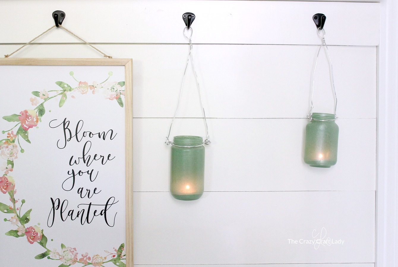 Did you know that you can turn just about any glass surface into a sea glass craft using sea glass spray paint? Follow this simple tutorial to make sea glass lanterns from empty glass jars.