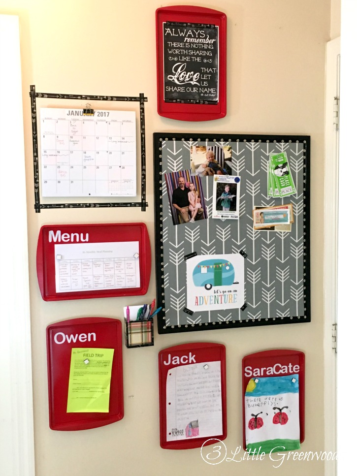 family command center on a wall with magnetic cookie sheets to stay organized