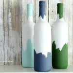 You won't believe how easy it is to make these DIY painted Decorative Wine Bottles. Empty a few bottles of wine, and save the empty bottles for a fun upcyled craft. Make the perfect wine bottle vase for a simple centerpiece.