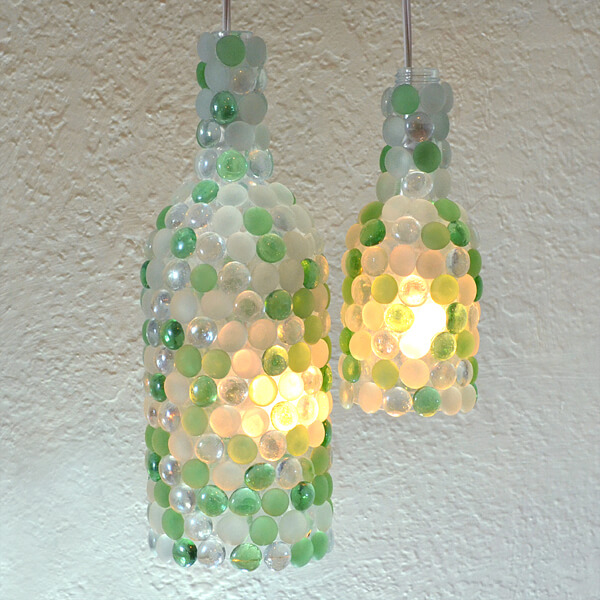 Check out these Beautiful and Functional Wine Bottle Crafts. Save those wine bottles for a unique DIY decoration for your home or garden. I'm loving these easy upcycled craft ideas!