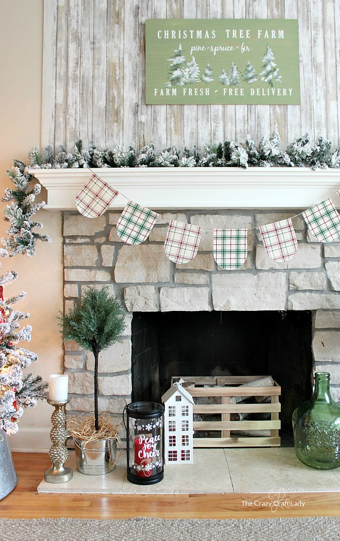 Come tour this cozy family room with tips for simple, budget-friendly classic Christmas decorating. Easy Christmas farmhouse decor ideas and Christmas home tour, plus ideas for decorating with two Christmas trees. DIY Christmas Tree Farm Sign.