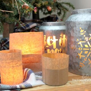 How to make simple brown paper bag lanterns, perfect for winter nights. This easy paper craft will cozy up any space at night. #luminary #paperlanterns