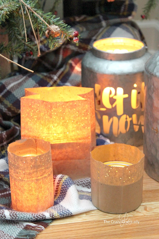 How to make simple brown paper bag lanterns, perfect for winter crafting. This easy paper craft will cozy up any space during winter. #luminary #paperlanterns