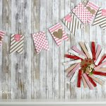 Make a simple DIY Valentine banner using dollar store gift bags and twine. Make this dollar store Valentine's Day craft to decorate your mantel or bookshelf.