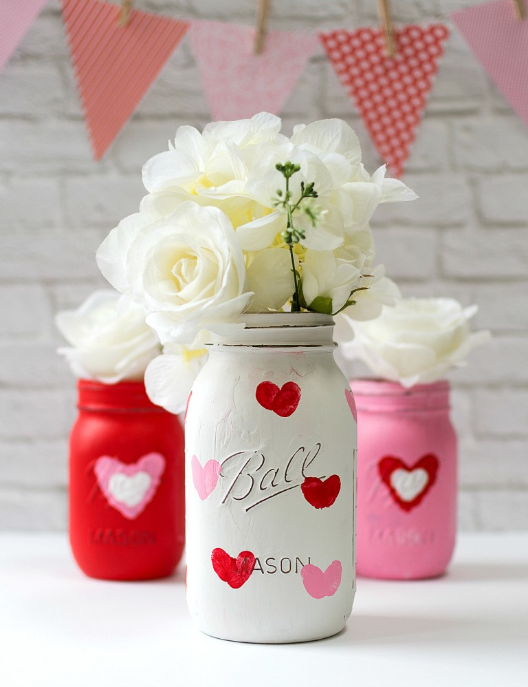 Thumbprint Heart Jars - Make it a handmade and heartfelt Valentine's Day with these 9 grandparent Valentines gift ideas. Give a handmade keepsake gift to grandma and grandpa that's filled with love.