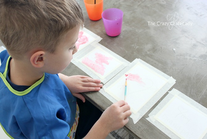 """These watercolor Valentine cards are a simple and fun Valentine's Day craft for both kids and adults. Paint over white paper, then watch your Valentine words and images """"magically"""" appear!"""