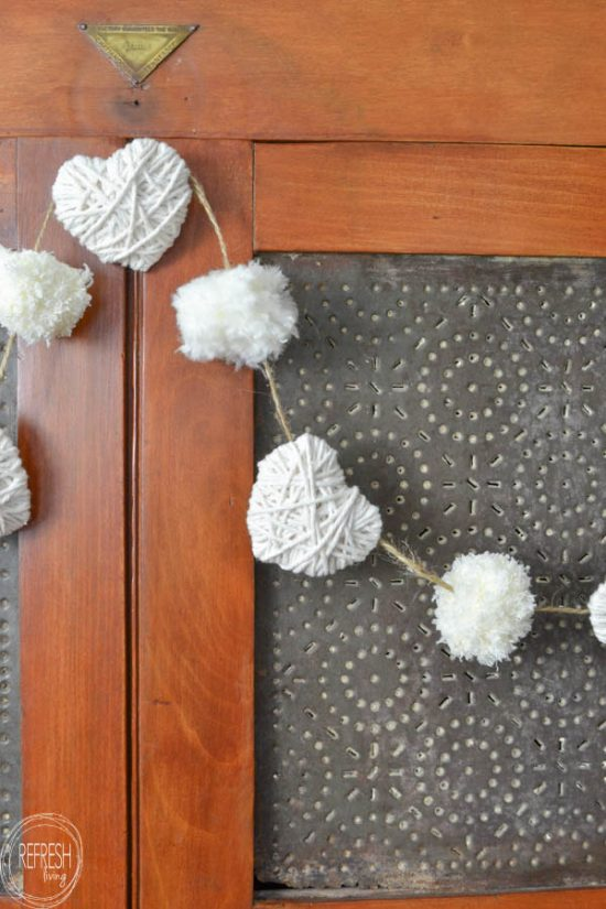 Farmhouse Yarn Heart Garland - Make your own gorgeous Valentine's Day decor with these 19 DIY heart decorations. These awesome Valentine tutorials provide plenty of decor inspiration.