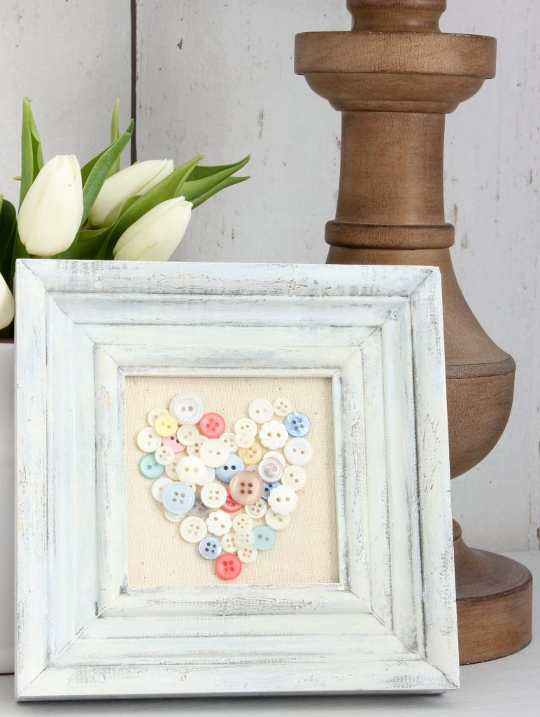 Button Heart Art - Make your own gorgeous Valentine's Day decor with these 19 DIY heart decorations. These awesome Valentine tutorials provide plenty of decor inspiration.