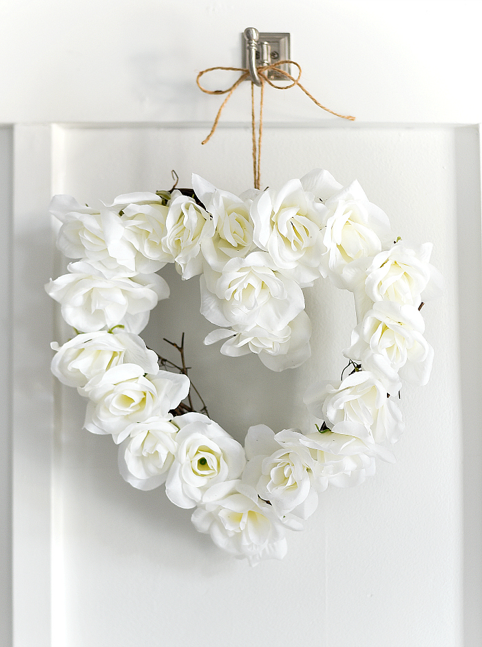 White Rose Heart Wreath - Make your own gorgeous Valentine's Day decor with these 19 DIY heart decorations. These awesome Valentine tutorials provide plenty of decor inspiration.