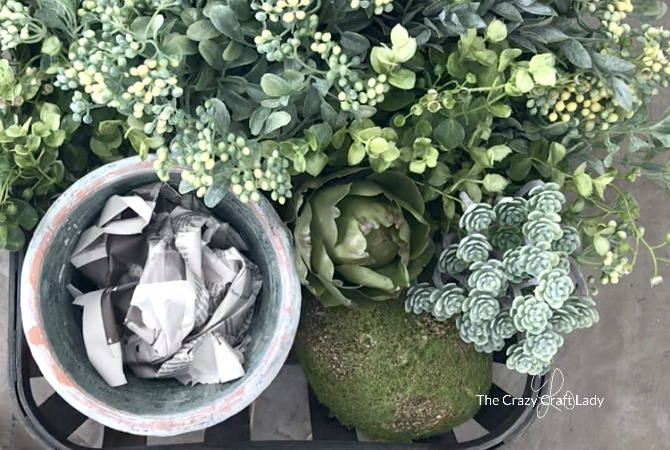 make a spring tobacco basket centerpiece - style with faux greenery stems and terracotta pot