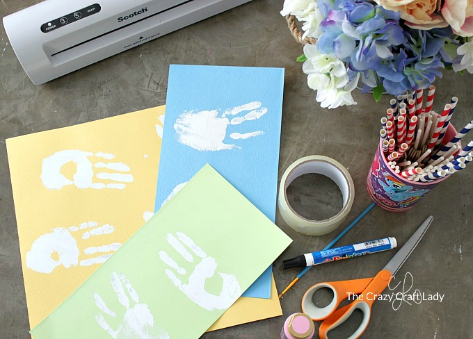 supplies for Easter bunny handprint craft with kids