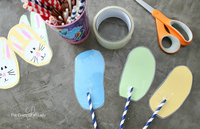 attaching straws to the bunny handprint craft