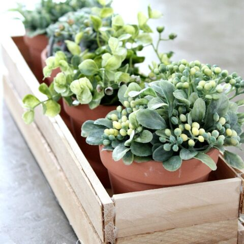 Learn how to make a simple DIY wood planter box using wood shims. This simple, small wooden box is perfect for spring plants or herbs.