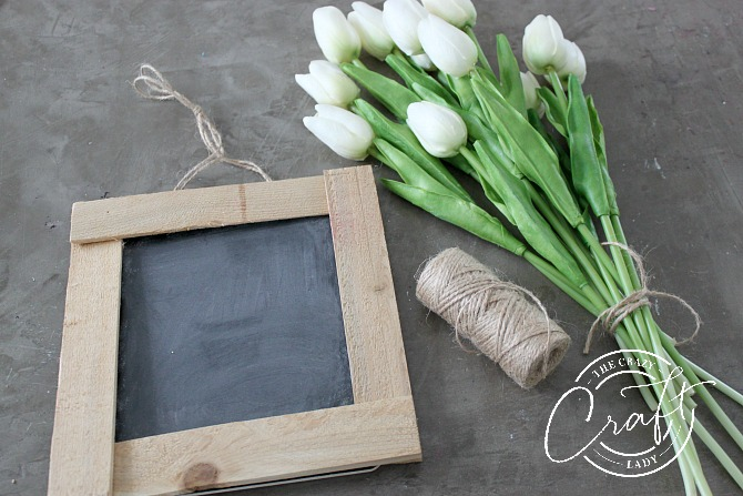 Whip up this DIY rustic chalkboard frame, using simple wood shims and a bit of glue!