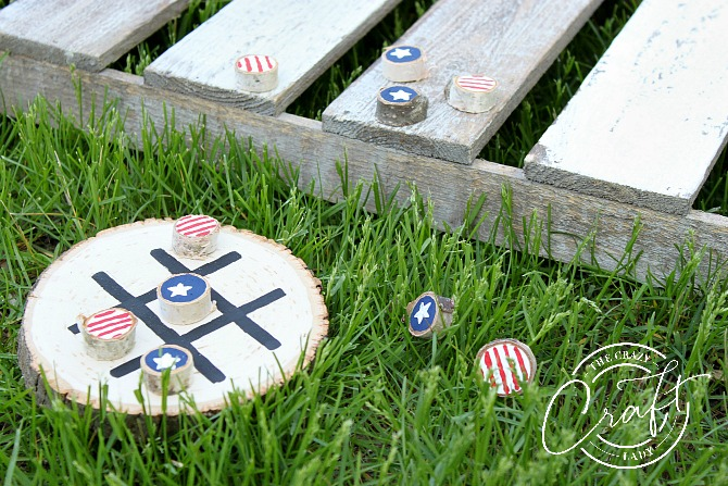 Summer DIY Tic Tac Toe game painted on a wood round