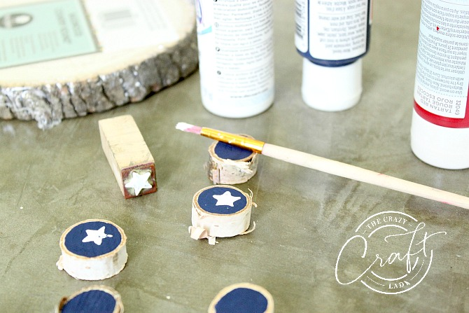 Painting tic-tact-toe wood round game pieces with acrylic craft paint