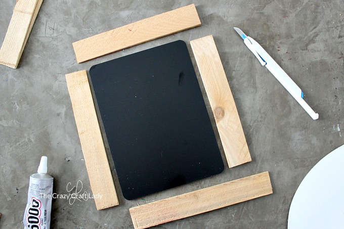 How to make a simple, rustic DIY chalkboard frame from wood shims - laying out the wood shim pieces for the frame